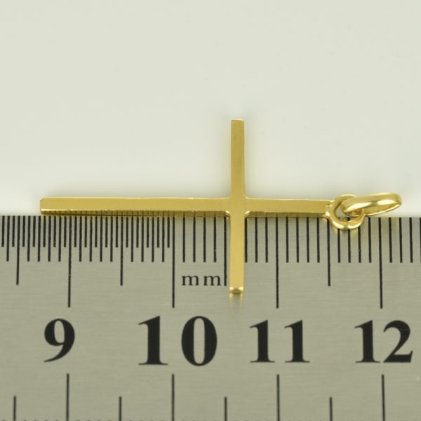 | Cruz de oro 18K Dimensiones: 18 x 28 x 1.2 mm