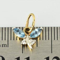 Colgante de oro 14K Dimensiones: 8 x 10 x 3 mm